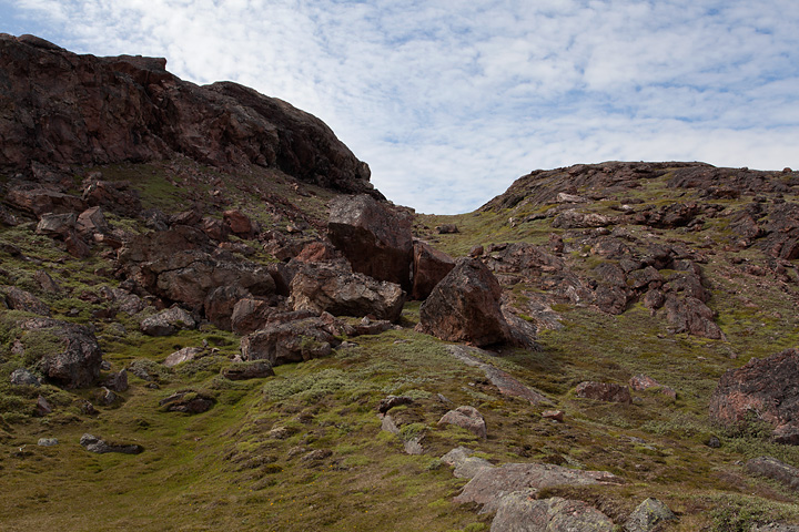 Heading up the eastern side of the ridge, the rock is a striking red colour