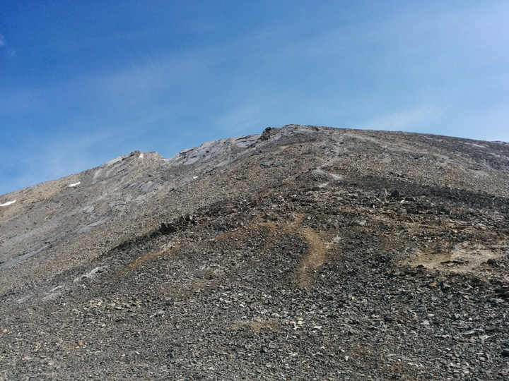 Above the helipad, a well-defined route leads to the false summit