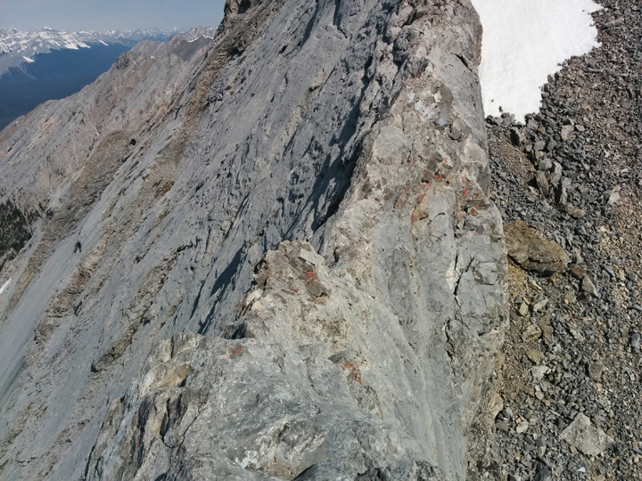 The crux of the ridge is narrow with small foot holds. I rode it like a horse, straddling the ridge with my legs!